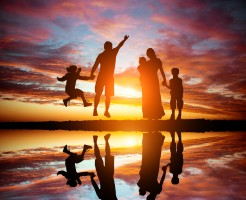 family on a background of the magnificent sunset